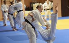 Tổng thống Nga Vladimir Putin trong một buổi luyện tập cùng thành viên đội tuyển judo quốc gia Nga. Ảnh: Sputnik