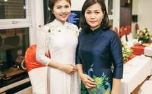 Minh Trang trong tà áo dài trắng dịu dàng