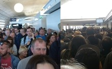 Hành khách được sơ tán khỏi khu vực có hành lý khả nghi. Ảnh: Sun