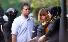 Đoàn Thị Hương trong lần ra tòa đầu tiên hồi tháng 3. Ảnh: AFP.