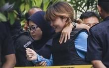 Nghi phạm Đoàn Thị Hương trong phiên xét xử ngày 14/4. Ảnh: AFP
