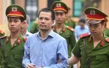 Bị cáo Nguyễn Xuân Thắng bị áp giải đến toà