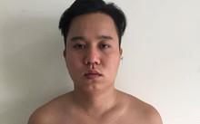 Nghi can Nguyễn Minh Cường khi ra đầu thú tại cơ quan công an.