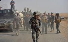 Cảnh sát liên bang Iraq tham gia chiến dịch diệt phiến quân Nhà nước Hồi giáo ở phía nam Mosul ngày 26/10. Ảnh: Reuters