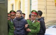Giang Kim Đạt bị dẫn giải tại tòa sơ thẩm.