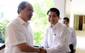 Bí thư Thành ủy TP Hồ Chí Minh Nguyễn Thiện Nhân và Chủ tịch Hà Nội Nguyễn Đức Chung tại buổi làm việc