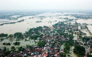 Dự kiến khoảng 10 ngày nữa, một số xã thuộc huyện Chương Mỹ, TP Hà Nội mới hết cảnh ngập úng. Ảnh: Nhật Quang