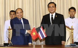 Thủ tướng Nguyễn Xuân Phúc và Thủ tướng Thái Lan Prayut Chan-o-cha. Ảnh: TTXVN.