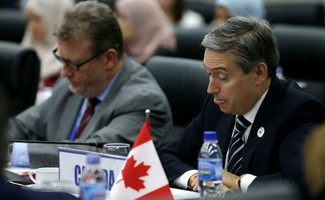 Bộ trưởng thương mại Canada, ông François-Philippe Champagnetại phiên họp về TPP ởAPEC 2017. Ảnh: Reuters