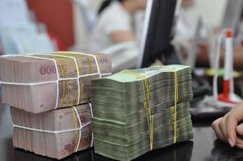 Thống đốc: Năm 2016, đồng Việt Nam mất giá 1,1-1,2% - ảnh 1