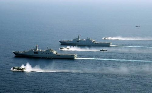 Việt Nam phản ứng việc Trung Quốc tập trận chiếm đảo ở Biển Đông - ảnh 1