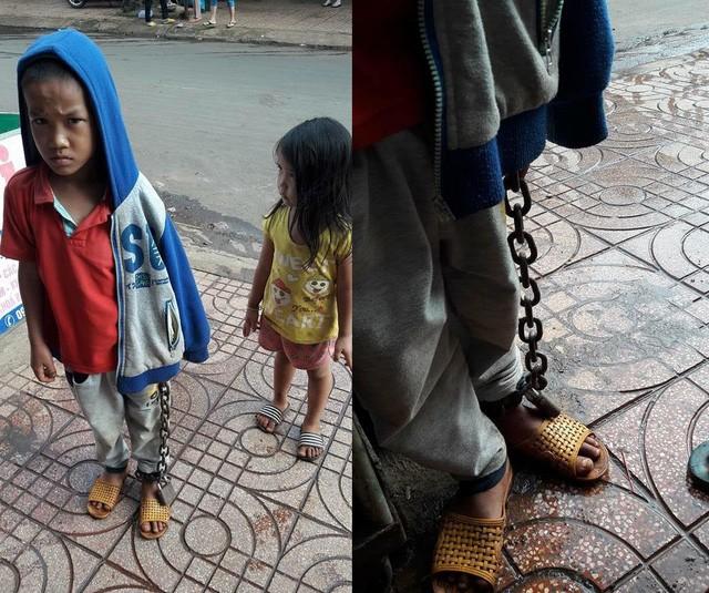 Công an vào cuộc vụ bé trai bị xích tay chân lang thang ngoài chợ - ảnh 1