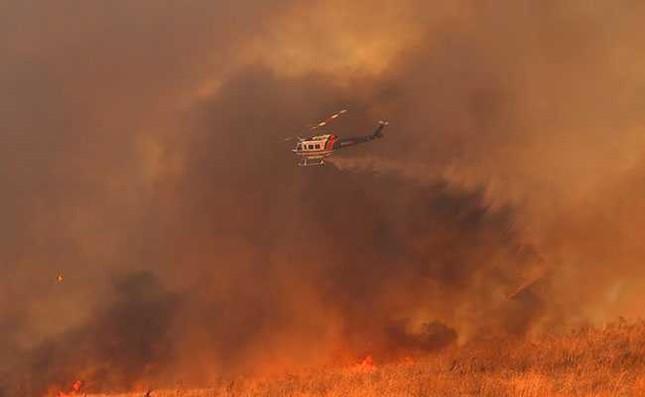 Mỹ: Cháy rừng dữ dội, ít nhất 10 người thiệt mạng - ảnh 1