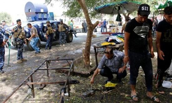 IS đánh bom tự sát ở Baghdad, 21 người chết - ảnh 1