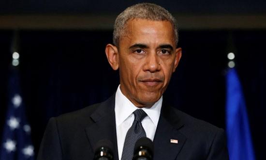 Obama lên án vụ phục kích cảnh sát là 'hèn hạ' - ảnh 1