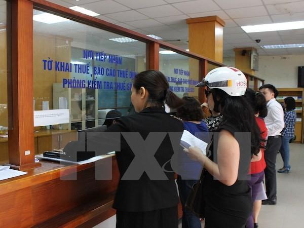 Hà Nội: Các đơn vị bị bêu tên bắt đầu nộp thuế - ảnh 1