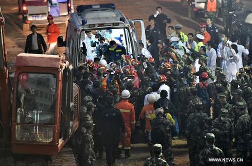 Nạn nhân đầu tiên sống sót trong vụ lở đất ở Trung Quốc - ảnh 4