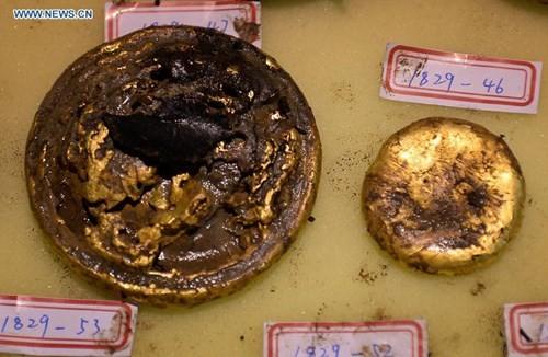 Phát hiện hàng trăm thỏi vàng bên trong mộ 2.000 năm - ảnh 5