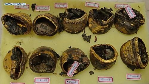 Phát hiện hàng trăm thỏi vàng bên trong mộ 2.000 năm - ảnh 6