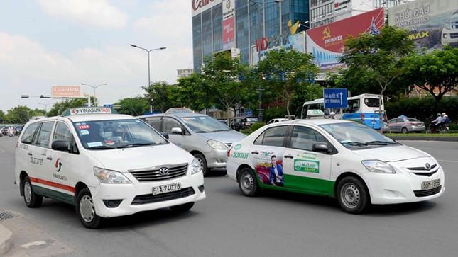 Bổ sung cơ chế quản lý Uber, GrabTaxi vào luật - ảnh 1