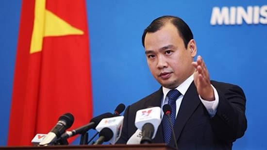 Việt Nam trao công hàm phản đối TQ bay thử nghiệm ở Trường Sa - ảnh 1