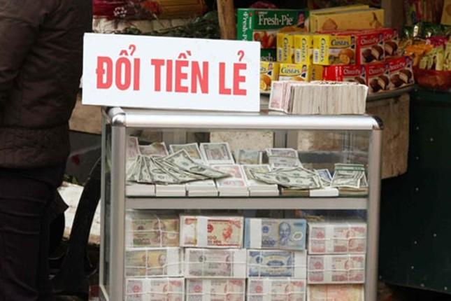Loạn phí đổi tiền lẻ dịp Tết Nguyên đán 2016 - ảnh 1