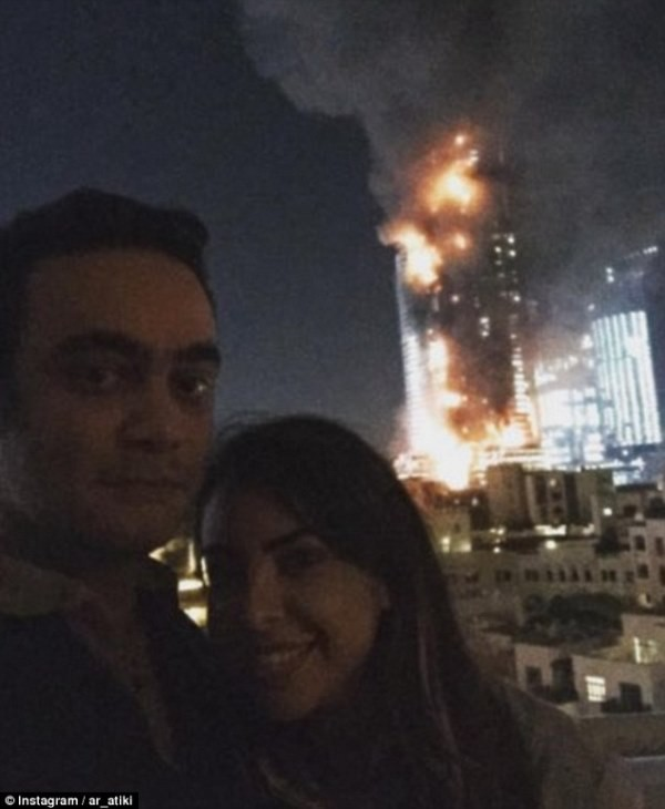 Khách sạn Dubai bốc cháy, đôi trai gái vẫn thản nhiên selfie - ảnh 1