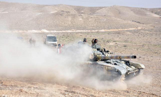 Quân đội Syria đánh chiếm sân bay Palmyra, khủng bố IS tan rã - ảnh 1