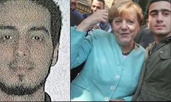 Báo Đức bác tin bà Merkel chụp ảnh 'selfie' với khủng bố - ảnh 1