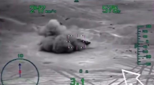 Video: Trực thăng, chiến đấu cơ Nga dội bom vào IS ở Palmyra - ảnh 1