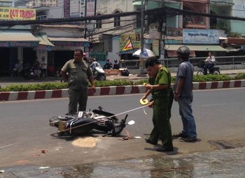 Tạm thời bắt giữ nghi can tạt axit 2 nữ sinh ở Sài Gòn - ảnh 1