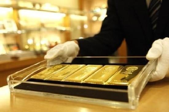 Vì sao giá vàng SJC thấp hơn thế giới lần đầu tiên sau 5 năm? - ảnh 1