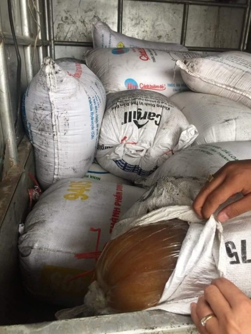Bắt giữ gần 1,5 tấn mỡ thối chuẩn bị tiêu thụ tại Hà Nội - ảnh 2