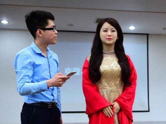 Robot Trung Quốc xinh đẹp: 'Đừng chụp gần, mặt tôi trông sẽ béo' - ảnh 2