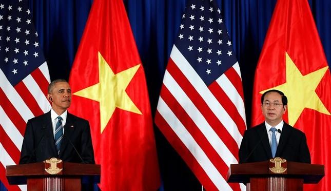 Ngày đầu bận rộn của ông Obama tại Việt Nam - ảnh 10