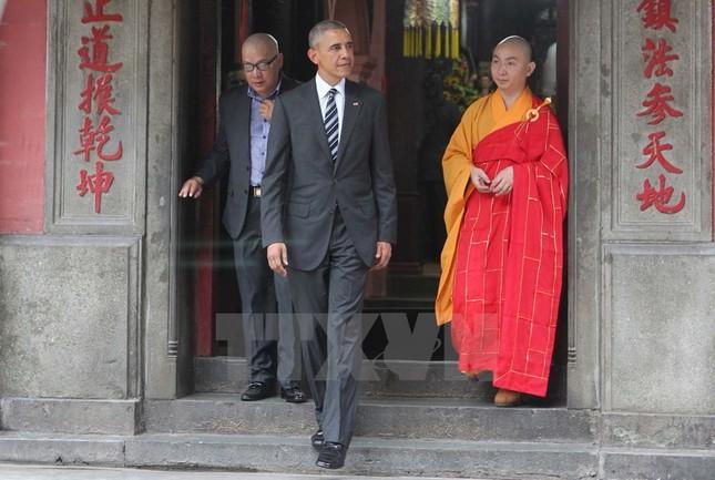 Những hình ảnh đầu tiên của ông Obama ở TP Hồ Chí Minh - ảnh 2