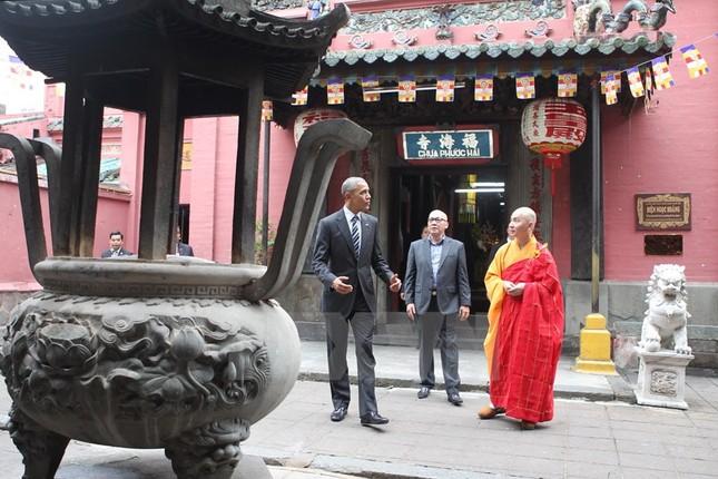 Những hình ảnh đầu tiên của ông Obama ở TP Hồ Chí Minh - ảnh 1
