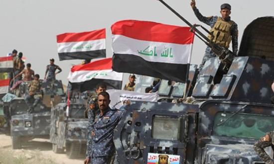 Chưa diệt xong IS, quân Iraq lục đục - ảnh 1