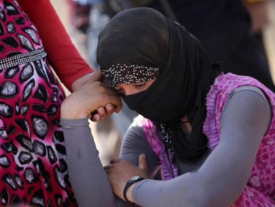 IS thiêu sống 19 phụ nữ vì từ chối làm nô lệ tình dục - ảnh 1