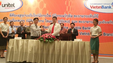 VietinBank triển khai dịch vụ Mobile BankPlus tại Lào - anh 1
