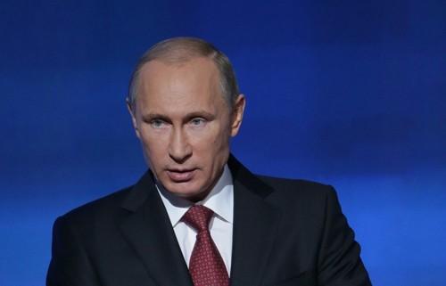 Forbes xếp tổng thống Putin là người quyền lực nhất thế giới năm 2014 - anh 1