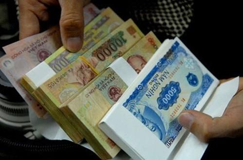 Tết Nguyên đán Ất Mùi 2015 sẽ không in tiền mệnh giá 5000 đồng - anh 1