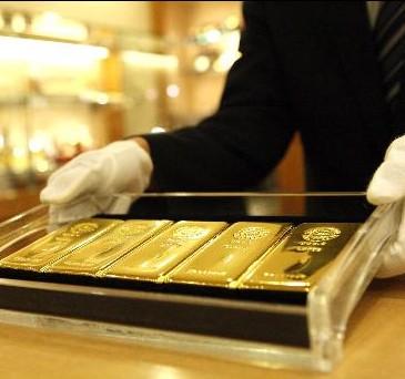 Giá vàng hôm nay 8/4: Đồng USD bứt phá đẩy giá vàng xuống khỏi đỉnh 7 tuần - anh 1