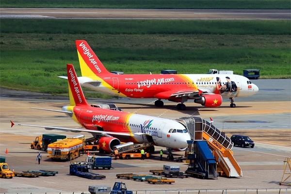 Cảng vụ hàng không miền Nam: Không có chuyện hành khách sàm sỡ bốn tiếp viên trên máy bay - anh 1