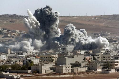 IS cáo buộc Mỹ và liên minh giết chết dân thường ở Syria - anh 1