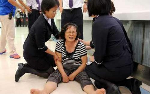 Giám đốc TransAsia xin lỗi các gia đình nạn nhân vụ máy bay Đài Loan rơi - anh 1