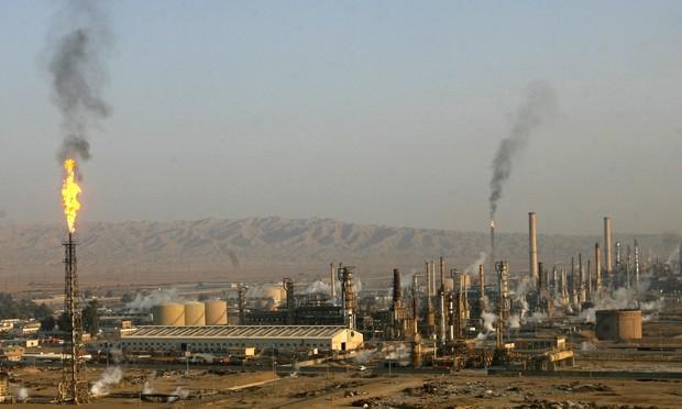 Khủng bố IS điên cuồng lao xe tự sát vào nhà máy dầu lớn nhất Iraq - anh 1