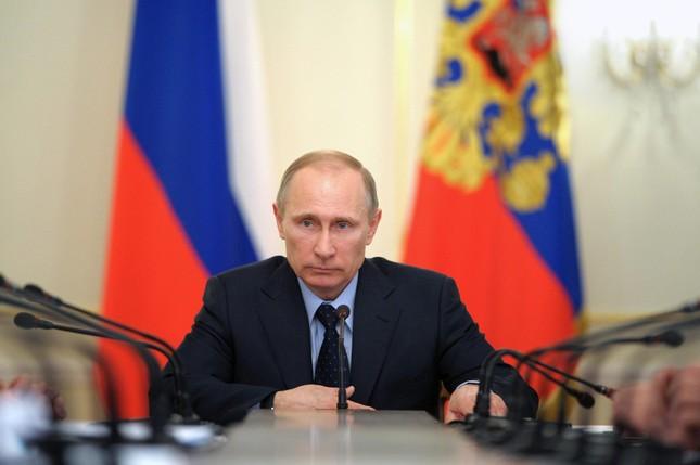 Tổng thống Nga Putin đứng đầu 100 nhân vật gây ảnh hưởng nhất năm 2015 - anh 1