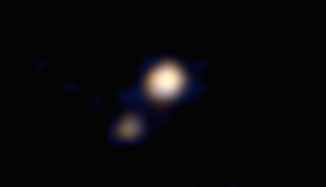 Phát hiện: NASA chụp được ảnh màu đầu tiên của sao Diêm vương - anh 1