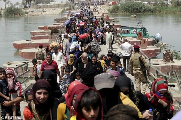 Tội ác ghê tởm của IS: Thảm sát 600 người, bắt cóc 600 thường dân Palmyra - anh 4